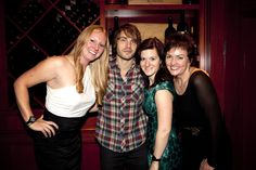 Indiana native and recording artist Jon McLaughlin poses with the Marketing ladies at the RN holiday party.