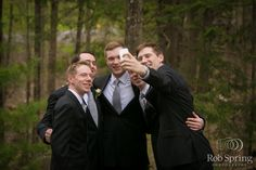 Love that the groomsmen are taking a selfie!   Wedding Planner:  http://www.debbiemcnairy.com/  Photographer:  http://robspringphotography.com/
