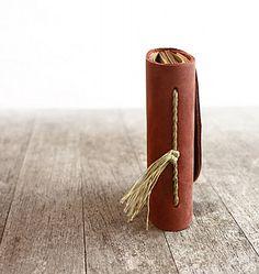 http://www.designsponge.com/2013/04/odelae-hand-stitched-journals.html#more-173246  http://assets4.designsponge.com/wp-content/uploads/2013/04/il_570xN.297816456.jpg