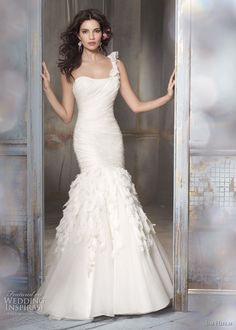 I want a dress like this, minus the one shoulder, minus the flowers at the bottom, and a softer, more romantic flowy bottom ...  and subtle bling!