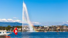 Photo about Beautiful view of the water jet fountain with rainbow in the lake of Geneva and the cityscape of Geneva at sunset, Switzerland. Image of madeleine, europe, colorful - 59315529 Geneva Hotel, Geneva Conventions, Canton, World Cities, Chengdu, Lausanne, Waterfall, Geneva, Finance