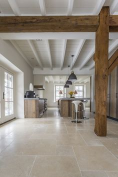 Stone Tile Flooring, Travertine Floors, Kitchen Flooring, Stone Kitchen Floor, Large Floor Tiles, Beige Kitchen, Doors And Floors, Modern Rustic Interiors, Tile Design