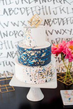 Vibrant Jackson Pollock Paint Splatter artist inspired wedding cake.