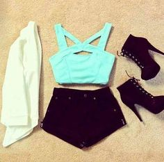 white cardigan, black high waisted denim shorts, turquoise crop top, black lace up ankle boot heels
