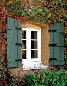 French cottage window with strapped shutters.