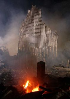 NEW YORK - SEPTEMBER 12, 2001: Rubble burns at the remains of the destroyed World Trade Center towers September 12, 2001 in New York City.