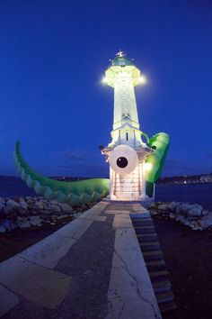 This is the work of street artist Filthy Luker. He challenges the viewer to see the world in a new way.   geneva lighthouse