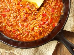 This hearty vegan lentil Bolognese sauce made with tomatoes and red bell peppers comes together in less than 30 minutes.