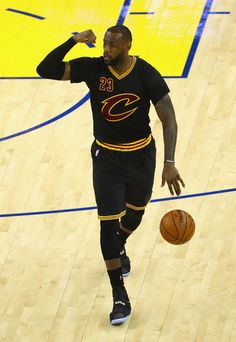 LeBron James Photos - LeBron James #23 of the Cleveland Cavaliers dribbles…