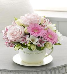 Soft pink flowers in a beautiful but simple teacup. #Homedecor at its finest