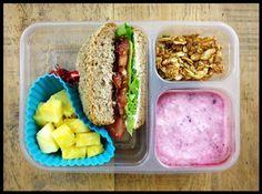 BLT sandwich (organic bacon, lettuce, tomato, and mayo on an Ezekiel brand whole-grain bun), pineapple chunks, plain yogurt mixed with berry sauce, and homemade granola (to mix into yogurt).