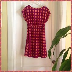 """It's Hip To Be Square"" dress!☮☮ Cutie, wootsie dress that you will absolutely have tons of fun in!! Zips all the way up the front from the hem to the neckline. Whimsical colors of peach squares on a magenta background. 100% polyester. From under arm to hem is 26 inches. Bust about 36 inches. Elastic waist. Paisley and Ivy Dresses"