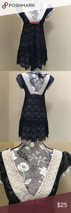 """Free People Deep V Lace Dress Super cute Free People Deep V Lace Dress size 2.  Excellent preloved condition. Cute detail around neckline and shoulders. Black lace with Slip lining.  100% nylon.  13"""" from underarm to underarm and 31"""" long. Could wear leggings under as well. Free People Dresses Mini"""