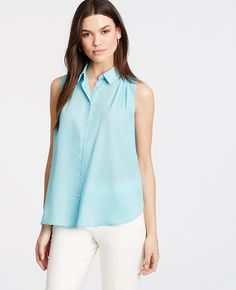 A perfect day-to-night piece, our flyaway shell tops off the season in a refined print and breezy, beautiful fabric. Point collar. Sleeveless. Button front. Flyaway side panels. Shirred forward shoulder seams. Shirred back yoke. Shirttail hem.