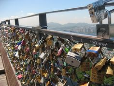 Seoul Tower in South Korea.  People write the name of their love on a lock, lock it on the fence and throw the key off the edge.