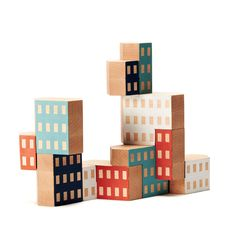 Blockitecture Art meets science in this set of nesting hand-painted blocks. The designer's intent was to create a timeless toy that challenges the user's creativity and understanding of physical laws. Awarded first place in the RIT Metaproject 03 design competition.