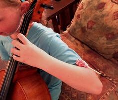 Use suckers to help young cellists keep their arms up.