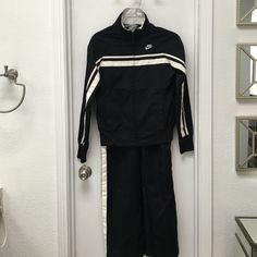 Nike track suit black and with off white detail XS Nike track suit black with off white detail size XS (0-2) like new condition, maybe worn a once. Please make me an offer.  Nike Jackets & Coats