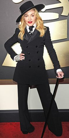 Last Night's Look: Love It or Leave It?   MADONNA   The Queen of Pop suits up – literally – for the show, rocking a Ralph Lauren Collection ensemble of wide-leg pants, a fitted blazer, shirt and tie, plus an oversize hat and a cane.