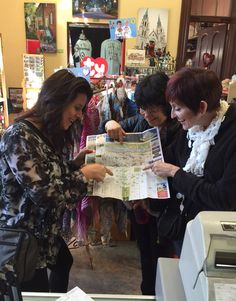 Savannah's a pretty nice place to be in February - particularly when home is snowy Alaska and Wyoming. Left to right: Joan Lower, Girdwood, AK; Lisa McDonald, Cody Wy; Lisa Fletcher, Anchorage make walking plans at the Savannah Visitor Center gift shop on MLK.
