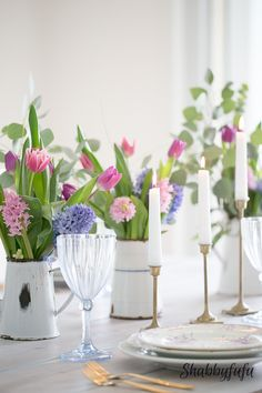 How to Achieve A Spring Look In A White Room with seasonal flowers. Hyacinths, tulips and French macarons on a plate bring color to a white room setting!