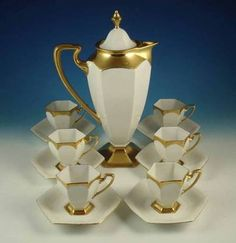 ANTIQUE 13-PIECE BERNARDAUD & CO. FRENCH LIMOGES CHOCOLATE SET Up for auction is an antique 13-piece Victorian-era chocolate set made by Bernardaud and Company in Limoges, France. All the pieces are