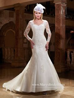 2a2e67dce Divine tulle and lace bridal gown featuring sweetheart neckline, detachable  long sleeves, matching lace