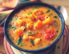 Coconut Chick Pea Soup -  3 cups veg broth 4 cloves garlic chopped 1 large yam/sweet potato, diced  1 yellow bell pepper, diced 2 Green apples, peeled, diced 1/2 cup chopped green chiles- mild  1 14-oz. can Muir Glen Fire Roasted Diced Tomatoes 1 15-oz. can chick peas, rinsed 1 14-oz. can coconut milk Lime juice 1 tbsp Thai curry paste (red or green) A pinch of cumin Sea salt and pepper, to taste   just before serving: 1-2 tablespoons chopped fresh cilantro or mint 1 cup packed baby greens
