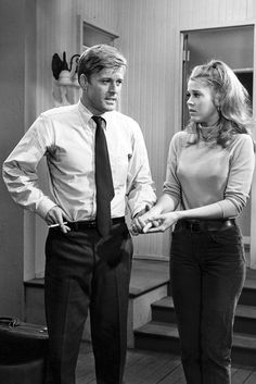 "Robert Redford in high-rise trousers, button-down shirt and tie on the set of ""Barefoot in the Park"", with Jane Fonda. 1967."
