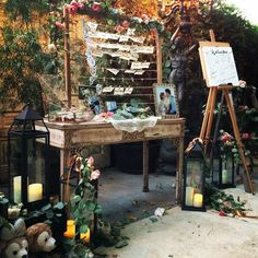 Vintage Guest Welcome Table - Medallion Table with its intricate carved detail and distressed finish, is the perfect piece in this garden wedding.  Boho, Glam, Shabby-chic, Rustic, Vintage. Available for rent from AmerivanVintageRentals.com