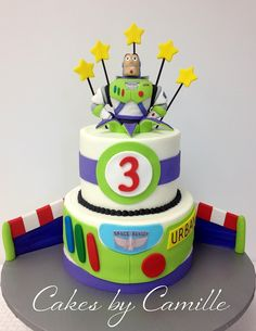 "Buzz lightyear cake, Happy Birthday ""to infinity and beyond!!"" Hand sculpted Buzz topper made from fondant and modeling chocolate."