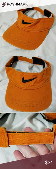 NIKE Burnt Orange & Black Velcro Visor Brand: Nike  Item: *Such a Great Cold Weather Color - Burnt Orange Cotton Visor *Black Swoosh Embroidered oncthe Front *Velcro Strap for You to find You Adjustable Strap *Size Tahe Has Been cut out, But I  Quite Sure it is OSFA & Cotton  *no trades, offers via offer button only*j Nike Accessories Hats