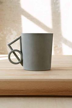 Handmade by Philadelphia's Ian Anderson, this cast porcelain mug has geo shapes that combine to form the handle. With textured raw clay at the outside, it's finished with a contrast of clear glaze on the inside. This handcrafted design piece works just as well on display as it does holding coffee.