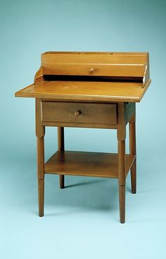 This is a small stand created between 1825-1850 in New Lebanon, New York.