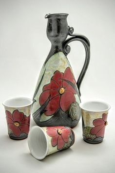 A personal favourite from my Etsy shop https://www.etsy.com/uk/listing/506059034/pottery-set-pitcher-cups-ceramic-jug-and