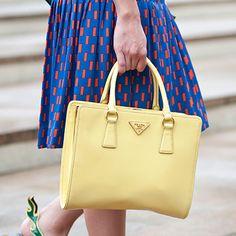 Spring 2013 Fashion Week Street Style - Light Yellow Prada Bag, Blue and red skirt.