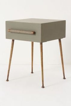 Midcentury Modern-inspired Nightstand / white ash wood, set on spindly brass legs and finished with neutral bamboo hardware