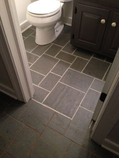Polyblend Grout Renew to spiff up the nasty grout in our bathroom! (How You Like Me Now, Grout? | Young House Love)