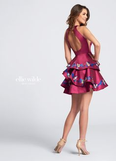 Ellie Wilde EW21701S - Sleeveless Mikado short A-line dress with hand-beaded printed halter neckline, cut-in shoulders, illusion sides, large keyhole back, asymmetrically tiered skirt trimmed with matching print. Sister dress to styles EW21702S, EW21703S, EW21704S, EW21705, EW21706S, EW21707S, EW21709S, EW21710, EW21711S and EW21712S.