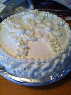 First cake I decorated with my first pastry bag and tip set,  Just playing with the different tips. The cake; white cake with a home made peach preserve, and home made butter cream frosting!