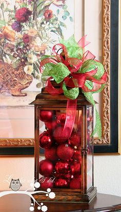 Easy DIY decor for Christmas - all you need is an interesting piece like this lanter, bulb ornaments, and ribbons.