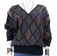 A personal favorite from my Etsy shop https://www.etsy.com/listing/245009377/vintage-leather-crochet-sweater-diamond