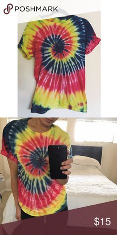 tie dye tee Handmade by me :) it's a combination of blue yellow and red! I've never actually worn it out besides to try on. Perfect condition :) Tops Tees - Short Sleeve