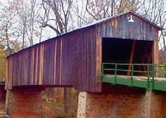 """This bridge was built in the 1880s by Washington W. King. It is 137.6 feet long by 16.35 feet wide, and the truss is Town Lattice style. This bridge goes over Euharlee Creek. It has also been formerly known as Lowry Bridge. There is a parking area. Admission is Free.  Donations are appreciated.  This covered bridge has been well maintained by the local folks. In The museum is located next to the bridge, in the """"Miller's House,"""""""