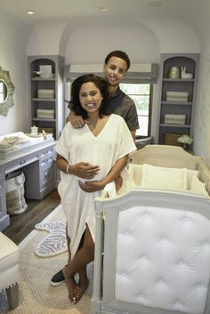 Space-saving bins throughout the room keep all of the baby's odds and ends organized.
