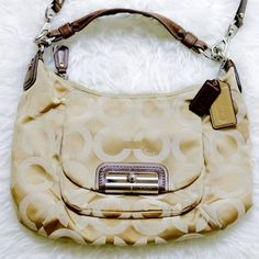 Coach Hobo Bag Comes with duster! Used but in very good condition. There are about 3 minimal, super small markings and you have to be up really close to see them. Honestly, I think they can be cleaned off. It has a removable cross body strap. Nice light blue color interior. Style #: m1082 16784 ☺️ Coach Bags Crossbody Bags