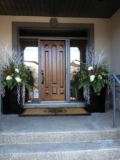 Whites brighten a shady portico. … Whites brighten a shady portico. More Whites brighten a shady portico. … Whites brighten a shady portico. Outdoor Christmas Planters, Christmas Urns, Front Door Christmas Decorations, Outdoor Decorations, Xmas, Country Christmas, Christmas Christmas, Primitive Christmas, Winter Container Gardening
