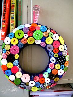 Wreath for Christmas GIANT Bright Purple smothered with sweetie looking Buttons. via Etsy.