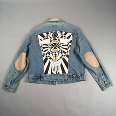 Custom-painted Levis jean jacket with leather elbow pads and matching collar. From AmericanDrifterMen on Etsy.