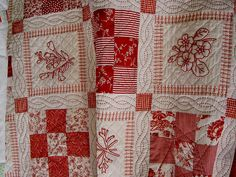love the layout! and the way the red work is presented! ..and the quilting! Could see in red & aqua....one with mostly red the other mostly aqua for the girls.